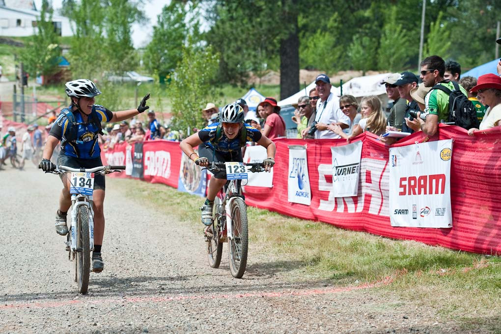 Terra Linda teammates Nicole Rehder (134) and Katherine King (123) enjoy finishing the JV Girl\'s race during the NICA California State Championships at Loma Rica Ranch in Grass Valley, California on May 16, 2010. © Robert Lowe.