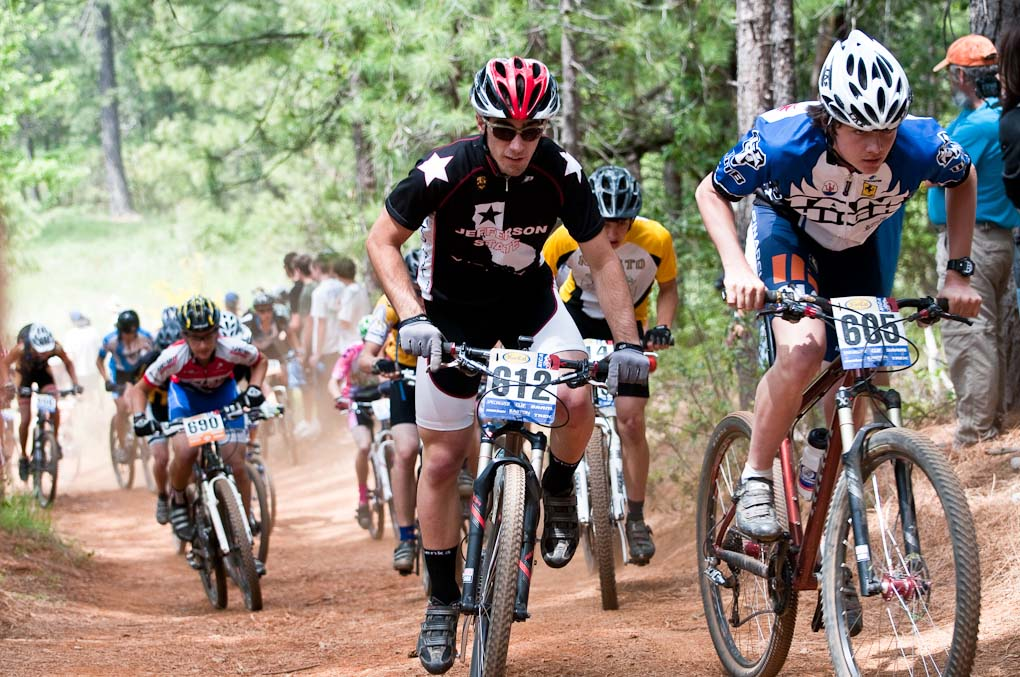 Bob Siegel of Tamalpais High (605) leads Jefferson\'s Carson Schmeck (612) up a fast climb at the Soph Boy\'s Division race during the NICA California State Championships at Loma Rica Ranch in Grass Valley, California on May 16, 2010. © Robert Lowe.