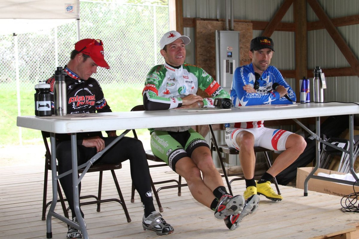 The men at the press conference after the race. © Amy Dykema