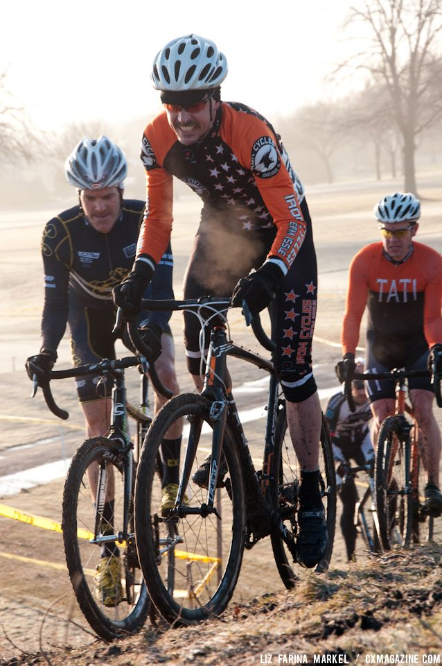 Dominic Casey (Iron Cycles) and Mike Norman (Pony Shop) charge up the hill in the Masters 40-plus race during the cold, early morning hours on Saturday. ©Liz Farina Markel