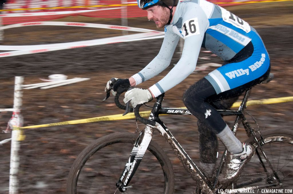 Isaac Neff (KCV Cycling Club) makes his way through the mud. ©Liz Farina Markel