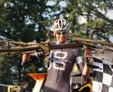 Aaron Tuckerman hoists his bike at the finish line after wining Cross Crusade #7. ©Pat Malach