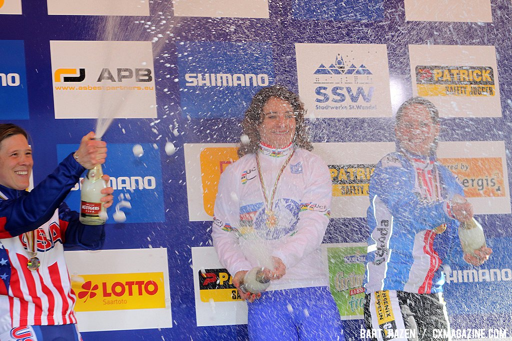 The champagne showers on the podium