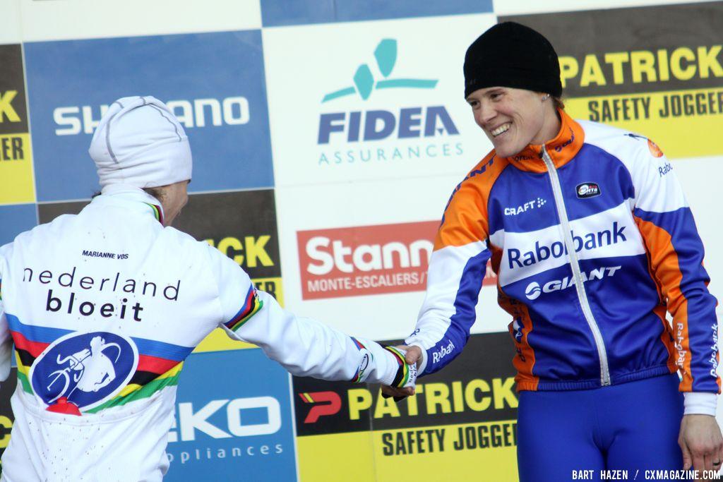 Katie Compton congratulates new teammate Marianne Vos on the win © Bart Hazen