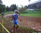 Stacey Barbossa running the mud. © Cyclocross Magazine