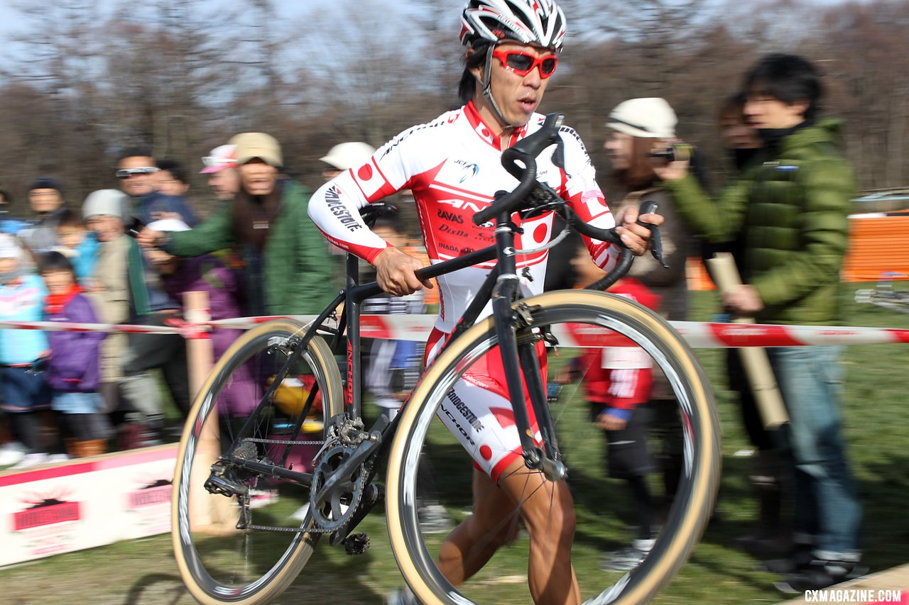 Tsujiura chasing early on in the 2011 Nobeyama, Japan UCI Cyclocross Race. © Cyclocross Magazine