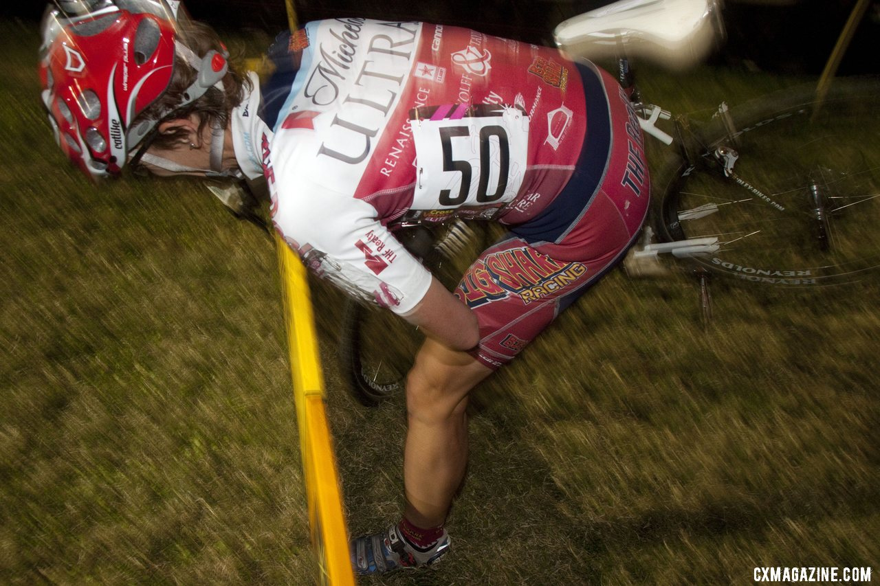 Handups and crowds distracted this rider, causing her to hit the barriers. ©Cyclocross Magazine