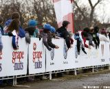 Fans banging the boards along the start/finish stretch gave the racers some added motivation. © Cyclocross Magazine