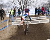 A ride dismounts into the uphill barriers - Junior Women, 2012 Cyclocross National Championships. © Cyclocross Magazine