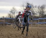 Nicole Thiemann leads a rider through the sandpit. © Cyclocross Magazine