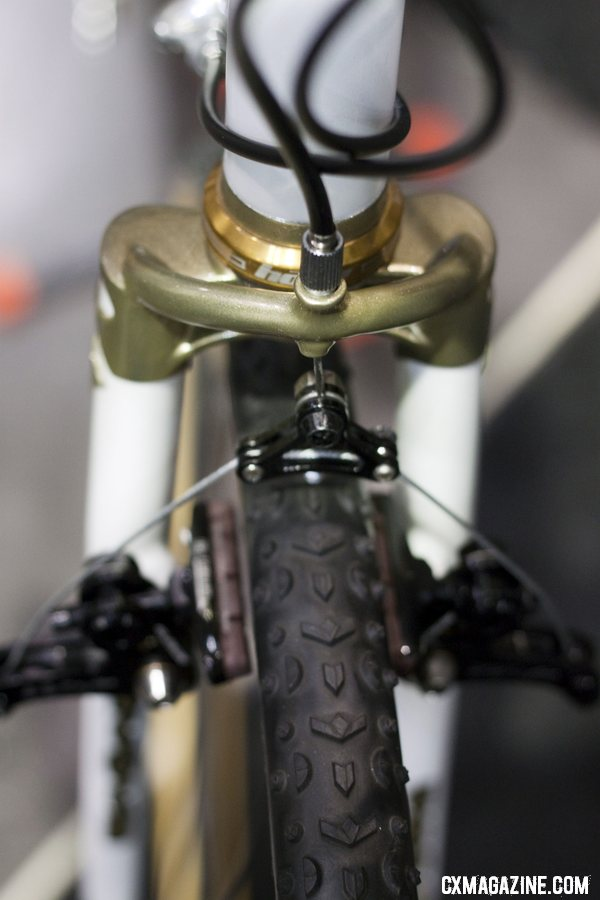 Peacock Groove\'s Erik Nored modified the fork crown to integrate a cable hanger. NAHBS 2012.  ©Cyclocross Magazine