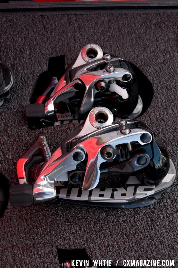 SRAM\'s new mid-cage Red rear derailleur, bottom, that is compatible with it\'s WiFLy expanded range 11-32 road cassette will hit the shelves in June. © Kevin White