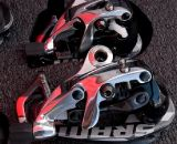 SRAM's new mid-cage Red rear derailleur, bottom, that is compatible with it's WiFLy expanded range 11-32 road cassette will hit the shelves in June. © Kevin White