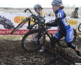 D2 Champ Erica Zaveta passing the D1 competition.  © Cyclocross Magazine