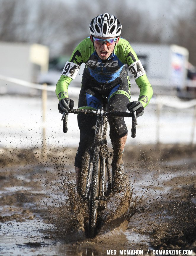 Tyler Schwartz focused on finding fast lines in the mud. Junior Men 17-18, 2013 Cyclocross National Championship. © Meg McMahon