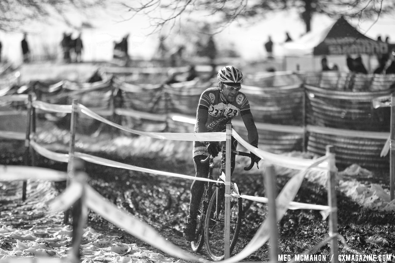 Gabriel Ion finds reason to smile heading towards the pits. Masters Men 40-44, 2013 Cyclocross Nationals. © Meg McMahon