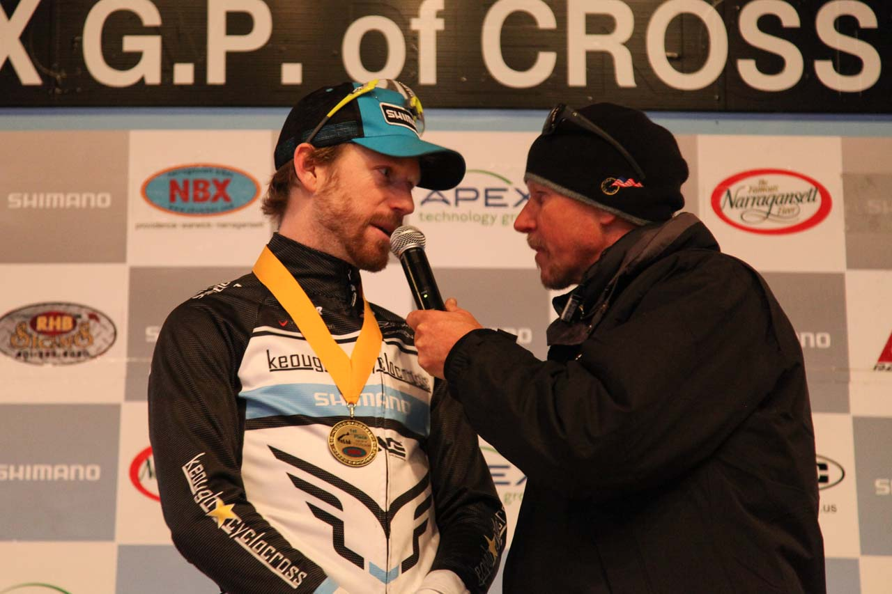 Shawn Milne discussing his series win with Richard Fries. © Meg McMahon