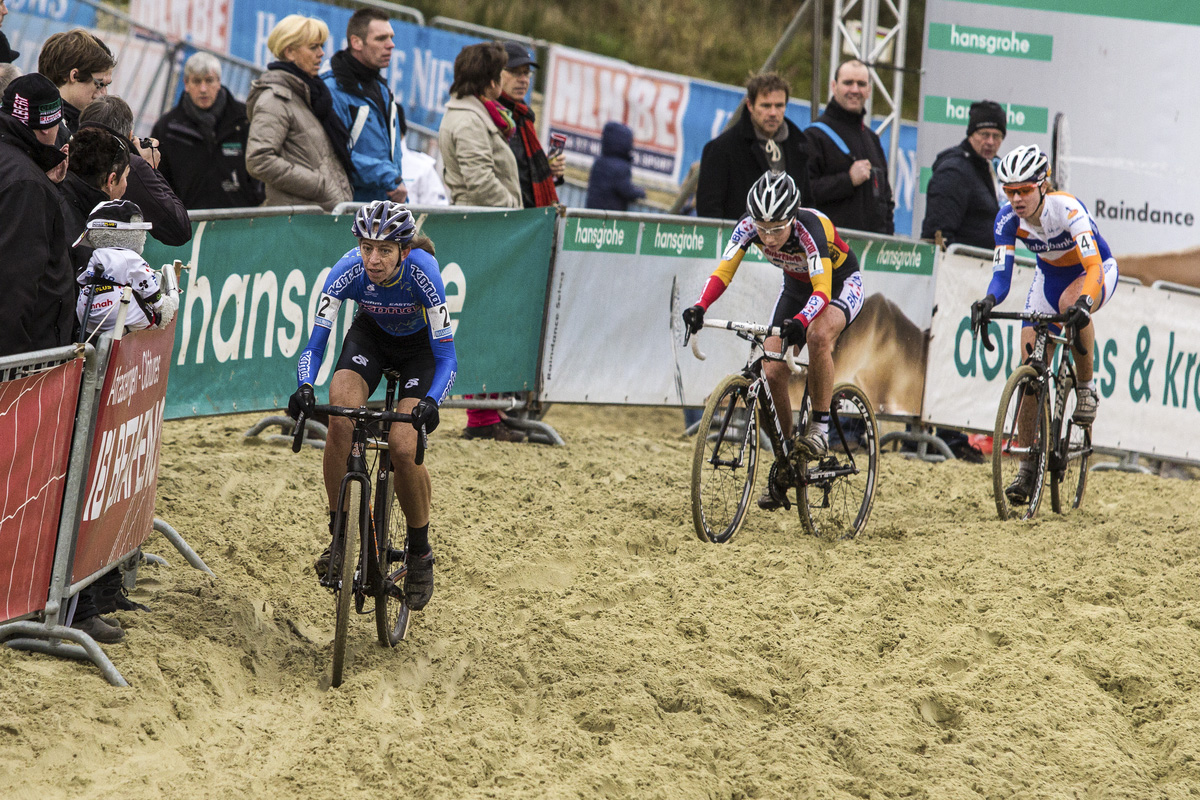 The Elite Women\'s podium finishers, (L-R) Helen Wyman, Sanne Cant, and  Sabrina Stultiens making their way through the sand. © Thomas van Bracht