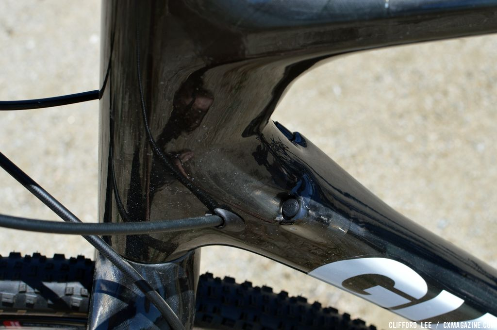 Internal cable routing. The plugged one is for the FD, to the left of that is the hydraulic line that eventually exits at the left rear chainstay going to the rear disc caliper on Adam Craig's Prototype Giant TCX Advanced - Sea Otter 2013. © Clifford Lee