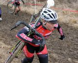 Sam Schneider picking her way through the slippery mud. © Amy Dykema