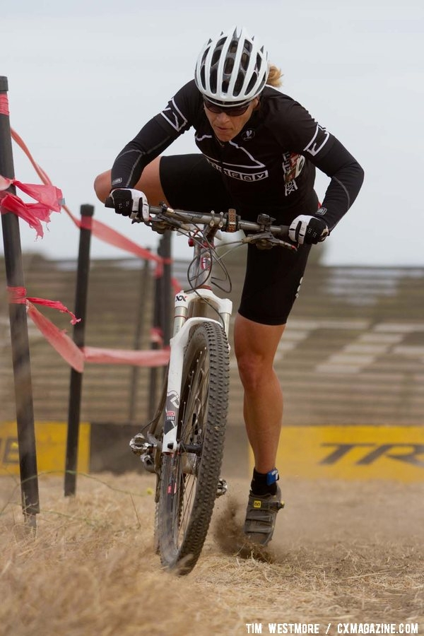 Helene Drumm remounts her mountain bike on the way to victory. © Tim Westmore