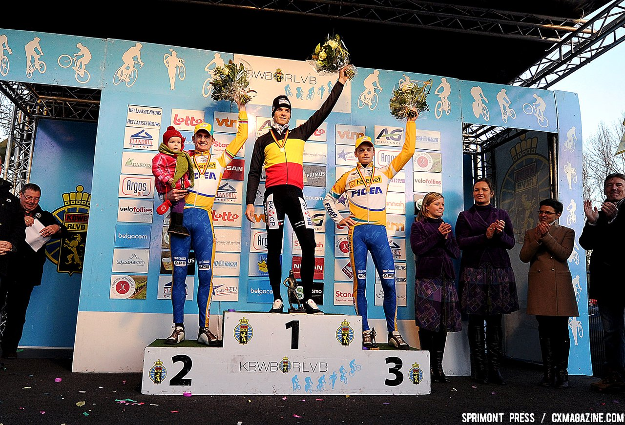 Bart Wellens (2nd) with his kid, Niels Albert Winner and Kevin Pauwels (3rd) on the podium of the 2011 Belgian Championship cyclo cross race in Antwerpen. Sunday Jan. 9, 2010. ( SPRIMONT PRESS / Laurent Dubrule )