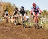 The lead group battling thru the mud on the back portion of the course. © 2011 Jody Grigg