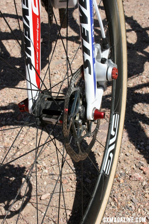 Brady shows off the Kappius front hub: hollow slotted carbon body means very light weight, but how will it shed mud this season? © Cyclocross Magazine