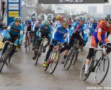 The 17-18 riders charge onto the course at the Elite World Championships of Cyclocross 2013. © Brian Nelson
