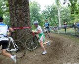 Livermon keeps his bike in the air around the barrier. © Cyclocross Magazine