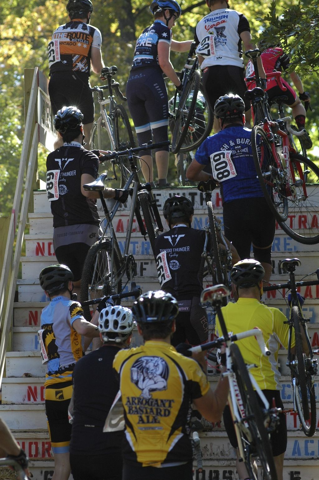 The Cat 4b\'s take the flyover at the Chicago Cross Cup at Hopkins Park in Dekalb Illinois.  © Aaron Johnson.