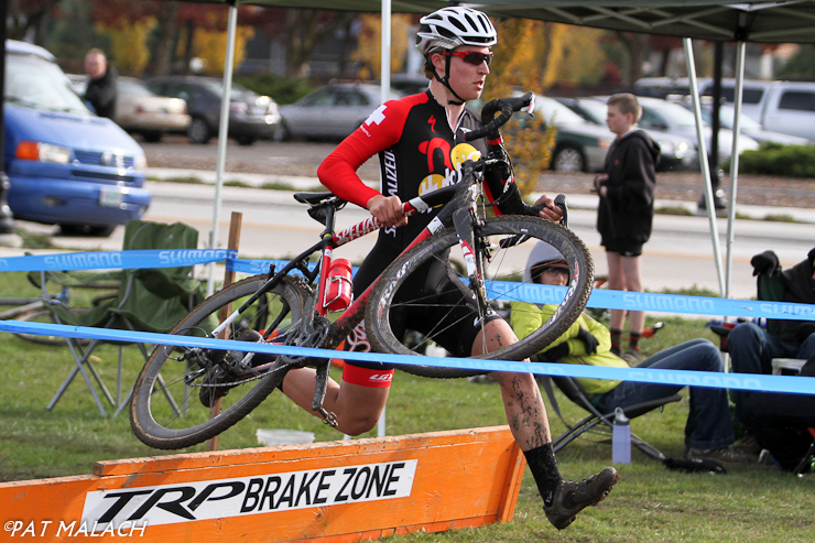 Junior Sam Rosenberg takes the barriers in the Men\'s A race. © Pat Malach