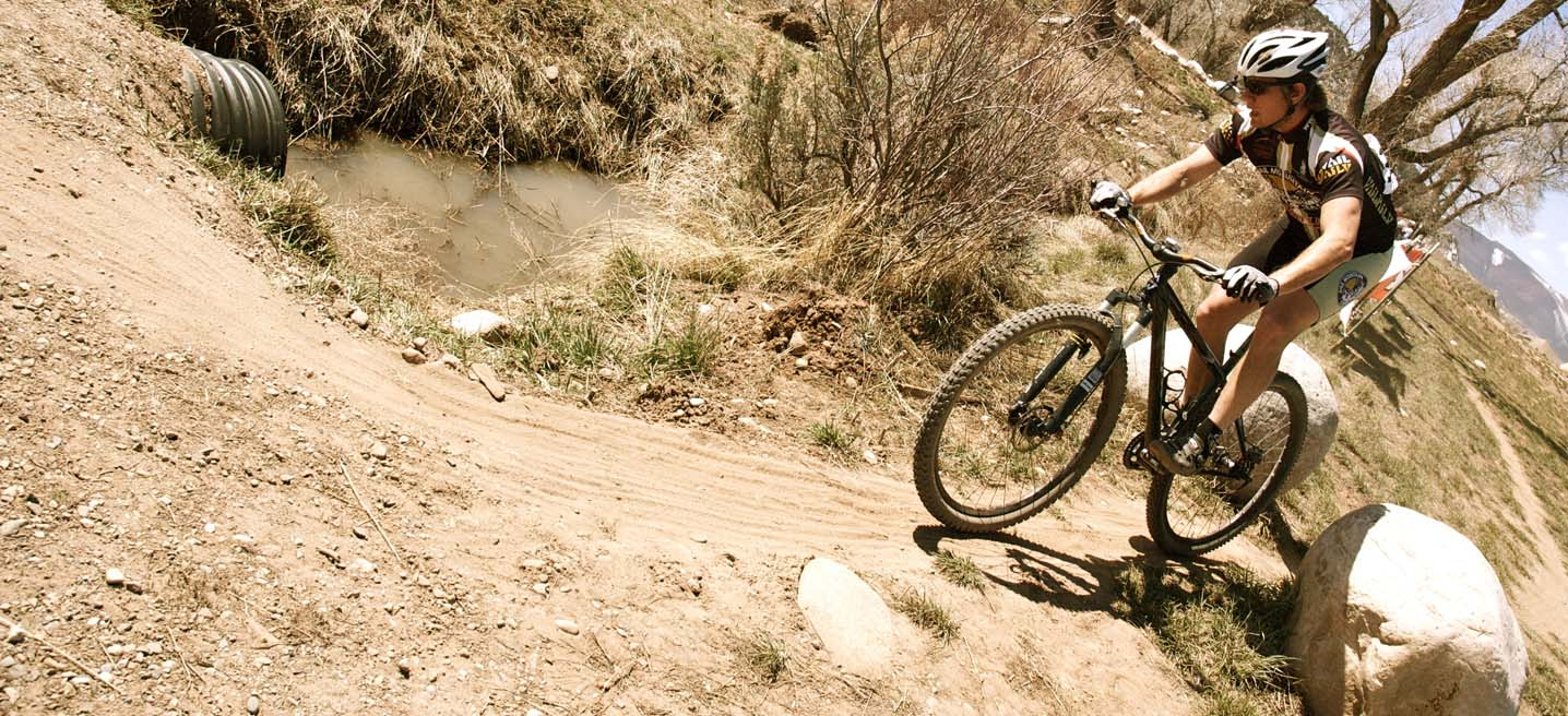 Bo Pihl enjoying a short descent on his single speed mountain bike. by Karen Jarchow