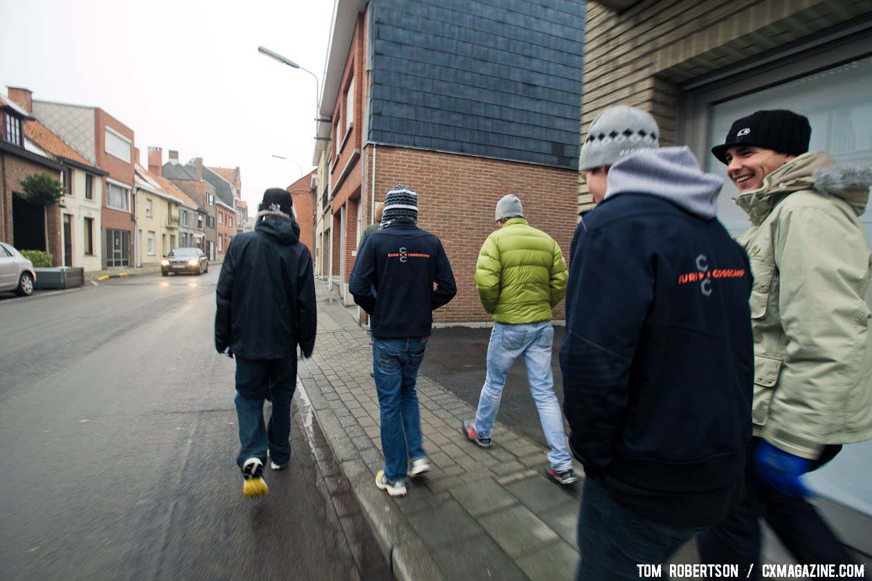 The crew heads into town for a well deserved treat of pizza and pastries after time on the bike. © Tom Robertson