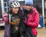 One very cold and muddy rider huddles for warmth. © Wil Matthews