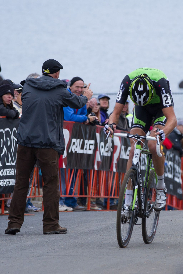 Announcer and Providence Cyclocross Festival Organizer Richard Fries gives Trebon one lap to go © Todd Prekaski