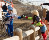 Taking handups in the men's 50-54 race at 2014 USA Cyclocross National Championships. © Mike Albright