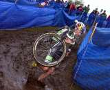 Tim Johnson splashes down in the mud. © Paul Weiss