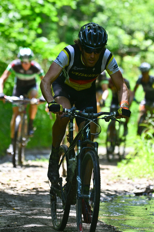 Garth Prosser (Specialized) leads the race through a muddy section of West Virginia state road. Pathfinder WV provided some of the local flavor to the race via a bacon station for finishers. © Fred Jordan