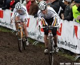 Hanka Kupfernagel and Marianne Vos seek a way through the mud