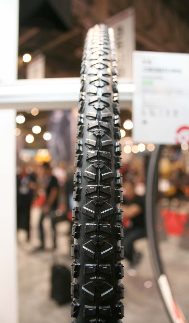 Hutchinson has a Crosstown tire, designed for commuters and cyclocross training. This Pirannha-like treaded tires is 650 grams at 32c.