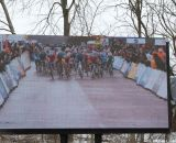 Watching the big screen while at the race at the Elite World Championships of Cyclocross. © Janet Hill
