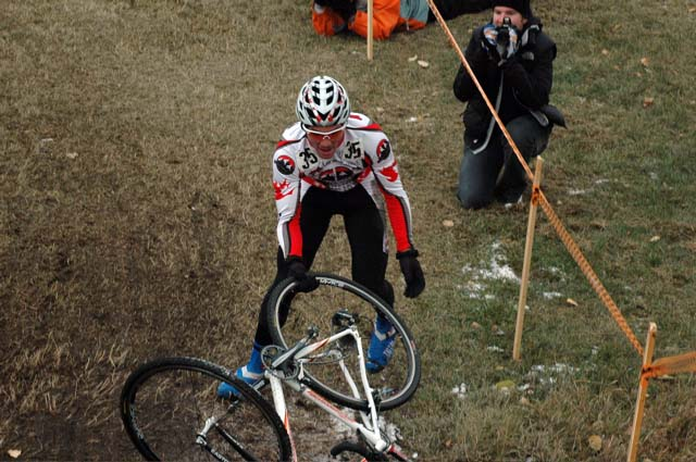 Evan Guthrie (Rocky Mountain) retrieving his bike after coming off it on one of the slippery downhills.