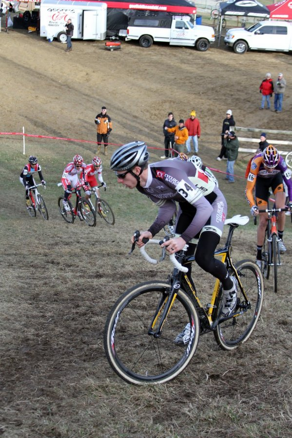 Tristan Schouten got the holeshot, led through the field, the barriers, and was the first one up the first hill section. Jingle Cross 2010 Day 3. © Amy Dykema
