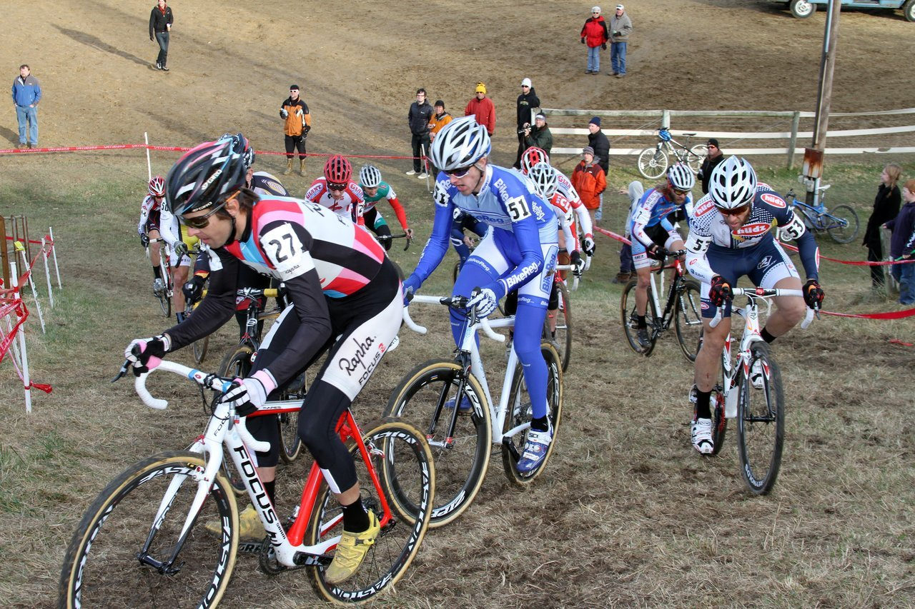 Everyone was trying to squeeze into the corner coming off the first climb on Lap 1. Jingle Cross 2010 Day 3. © Amy Dykema