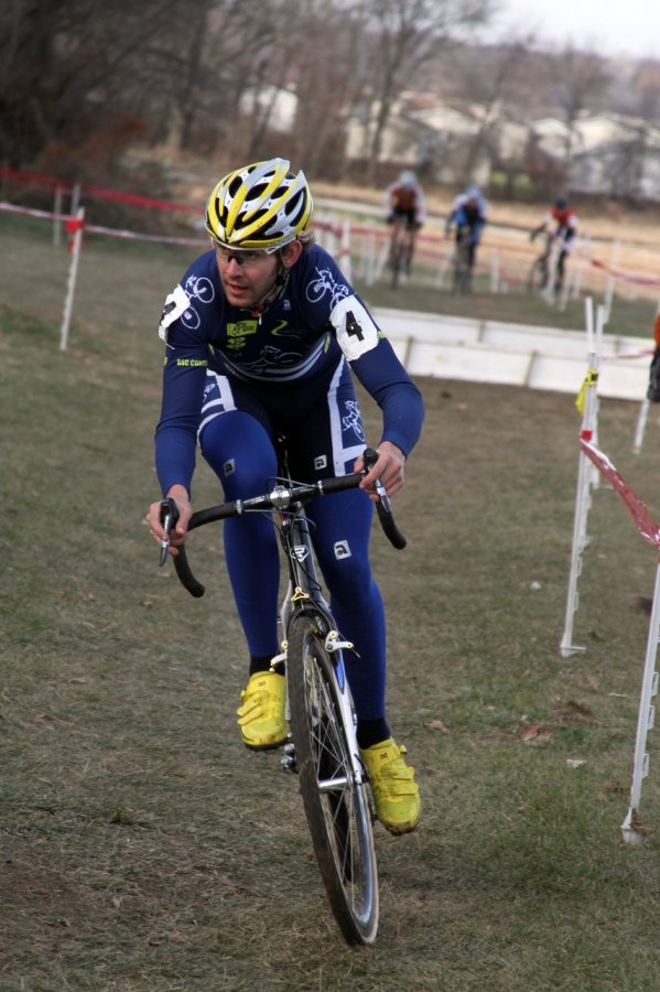 Mike Sherer eyes the hill after coming through the barriers. Jingle Cross 2010 Day 3. © Amy Dykema