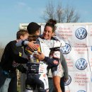 Teammates Duke and Miller hugging on the podium © Amy Dykema