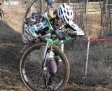Kaitie Antonneau shouldering the bike up the hill. © Amy Dykema
