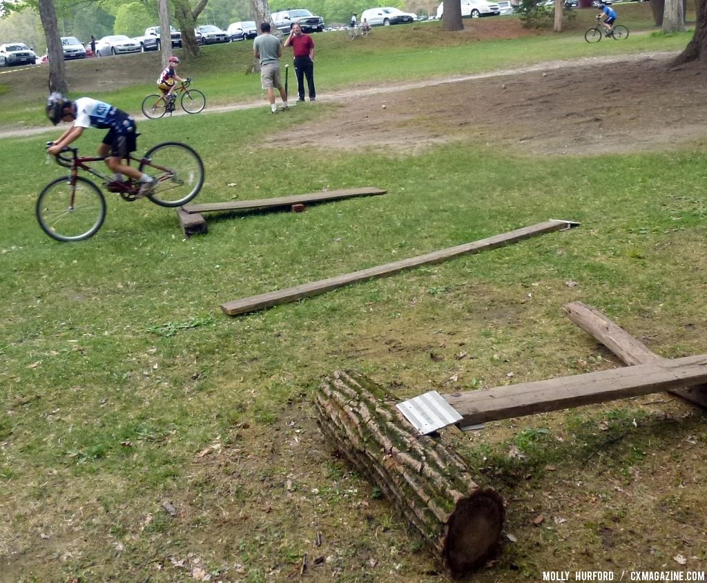 Practicing riding in a straight line, over a board and log setup © Cyclocross Magazine