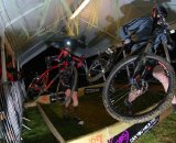 Riders tackle the barriers through the beer tent